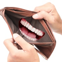 """""""Open Wide,"""" said the dentist, """"No, Not Your Mouth. Your Wallet!"""