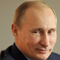 Putin Laughs At Claims Of Collusion